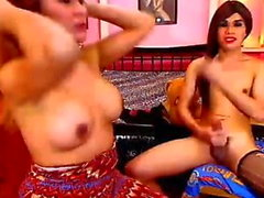 Two shemale with big tits have anal sex on cam