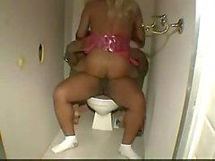 Glory hole shemale sex in a toilet