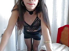 Sexy TS in leather skirt dancing around