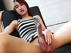 Asian tranny Pooh plays with her bat in her living room