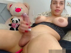 big boobs latina teen tgirl stroking her big dick and smoking on cam