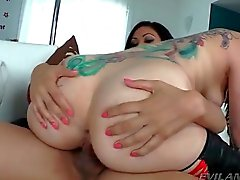 Big ass girl covered in tattoos rides shemale cock